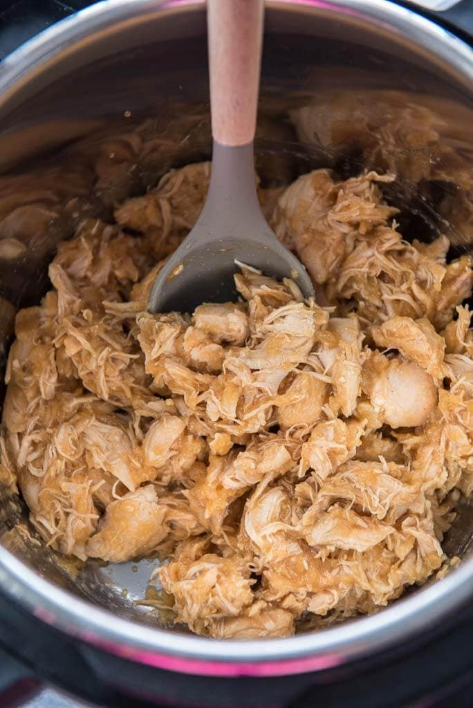 Mongolian chicken in instant pot with serving spoon
