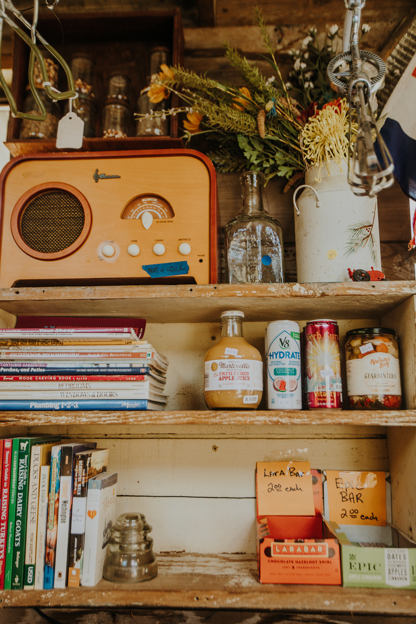 A vintage radio, books and shelf-stable goods sit on the shelves.