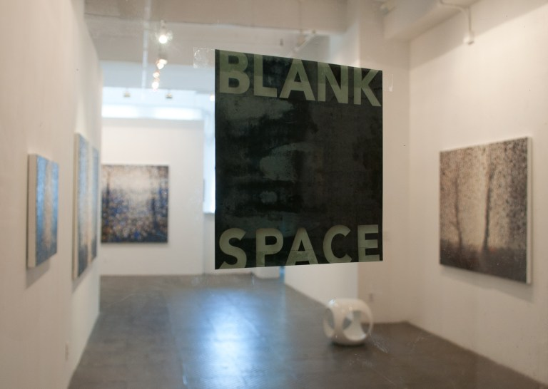 Blank Space sign on glass door with paintings by Randall Stoltzfus solo exhibit in background
