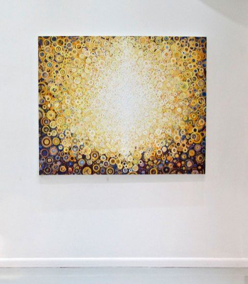 """Yellow and white patterns of circles glow from the painting """"rajah"""" by Randall stoltzfus, shown here in a gallery install in New York, NY"""