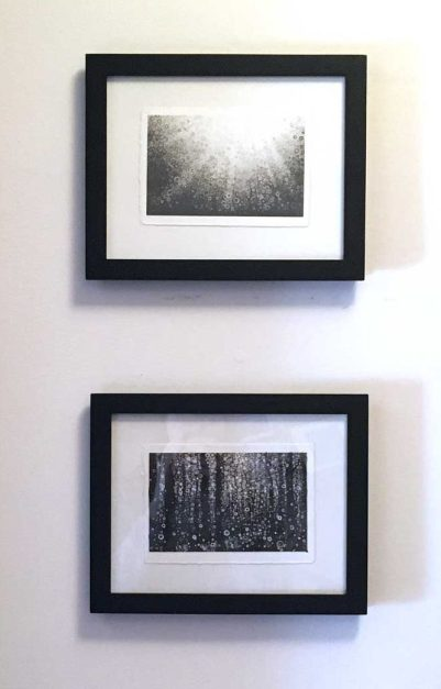 Two small monochrome prints by Randall Stoltzfus framed and hanging on the wall