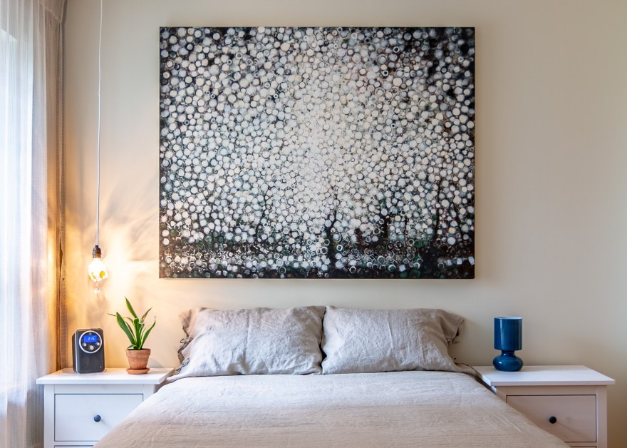 """The painting """"Bare"""" by Randall Stoltzfus hangs over the bed in the artist's Brooklyn apartment"""