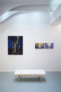 Randall Stoltzfus' paintings Rainmaker, Through, and Held hang at Blank Space Gallery in New York in November of 2019