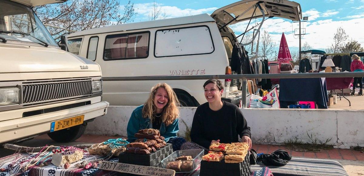 smiling girls selling food at Best Flea Market In Algarve