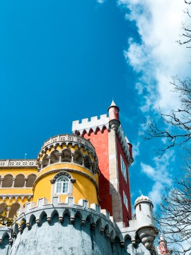 red and yellow castle in a blue sky