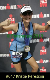 Photo of 2013 Ironman 70.3 World Championship competitor Kristie Peressini proudly and happily wearing her finisher medal.