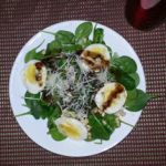 Photo of spinach salad, hardboiled eggs, pine nuts, finely shredded cheese, and homemade dressing