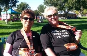 Photo of Karen Whelan and a friend after the Pumpkinman Triathlon road races. (Photo by Bonnie Parrish-Kell)