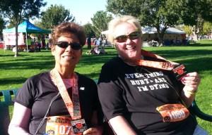 Photo of Karen Whelan and a friend after the Pumpkinman Triathlon road races. (Photo by Bonnie Parrish-Kell)