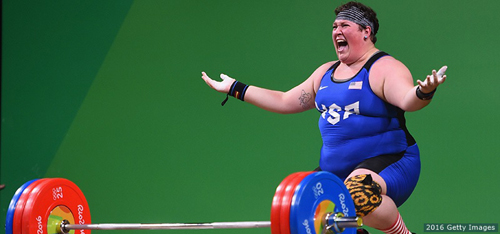 U.S. weightlifter Sara Robles reacts to winning bronze medal after her last lift