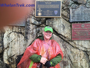 Karen Whelan stands next to several Machu Picchu place plaques