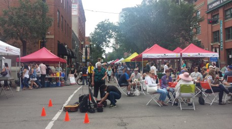 Seating and Music at the center of the cross roads in Edmonton's 104 St Farmers Market