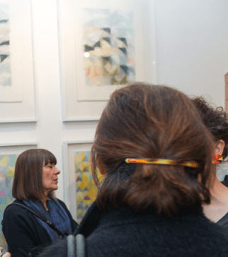 Joanna Bowring in front of Emma Neuberg's work at The Geometrics, 2013, a Slow Textiles Group event (designed, devised and delivered by Emma Neuberg)