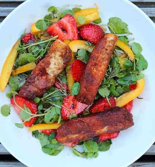 halloumi chips on a strawberry and rocket salad