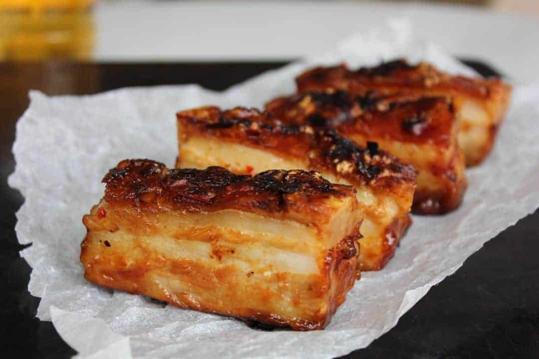 A side view of crispy pork belly slices