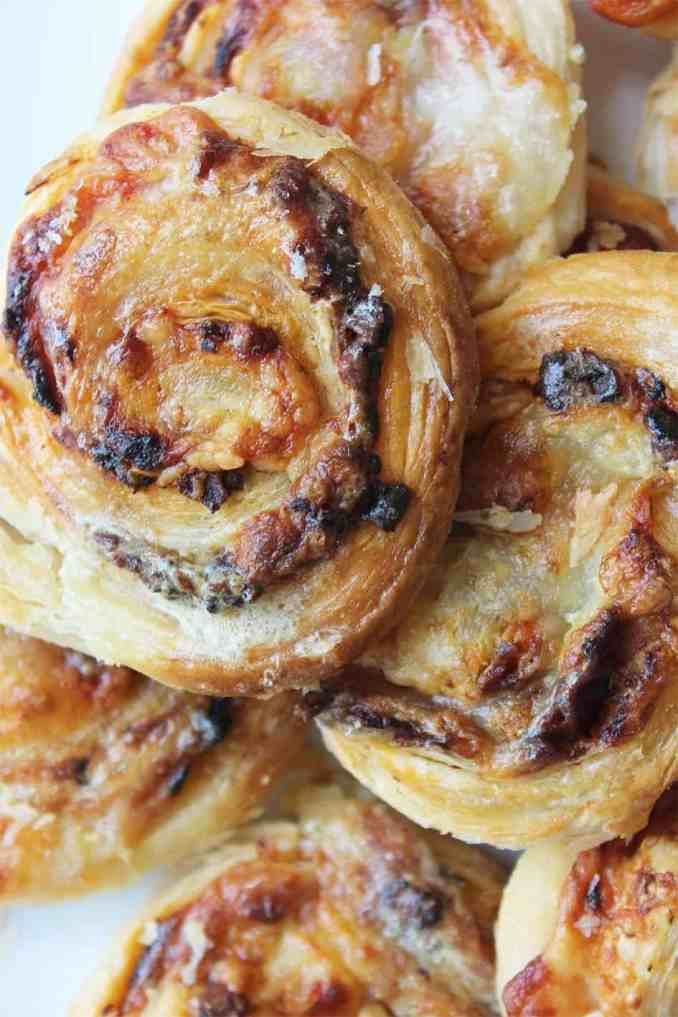 These puff pastry pinwheels are a quick and easy party food.  You can serve warm, or make a head of time and they are ready in less than 30 minutes