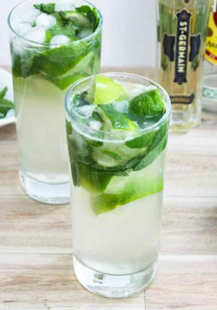 Two glasses of mojito elderfower cocktail on a wooden surface