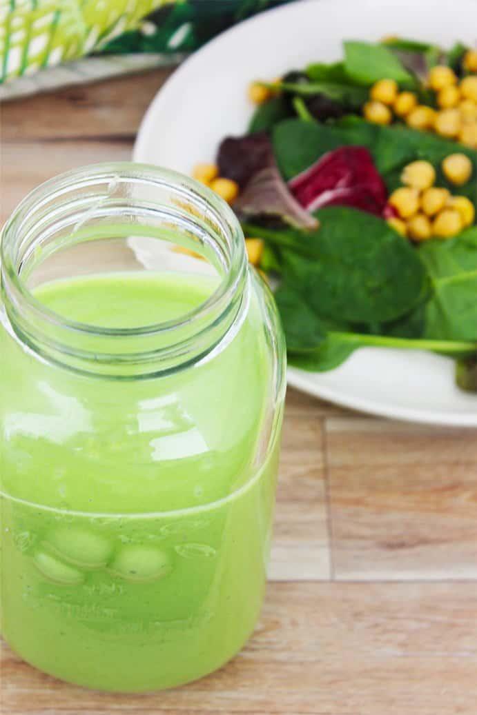 closeup of green salad dressing in a mason jar