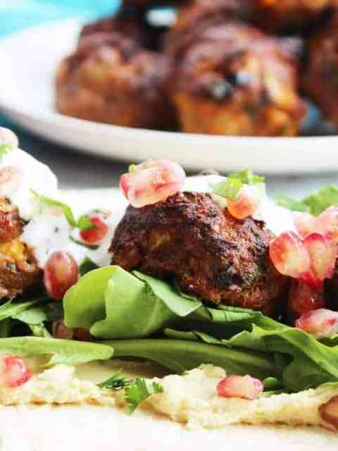 Lamb meatballs dressed on a bed of salad