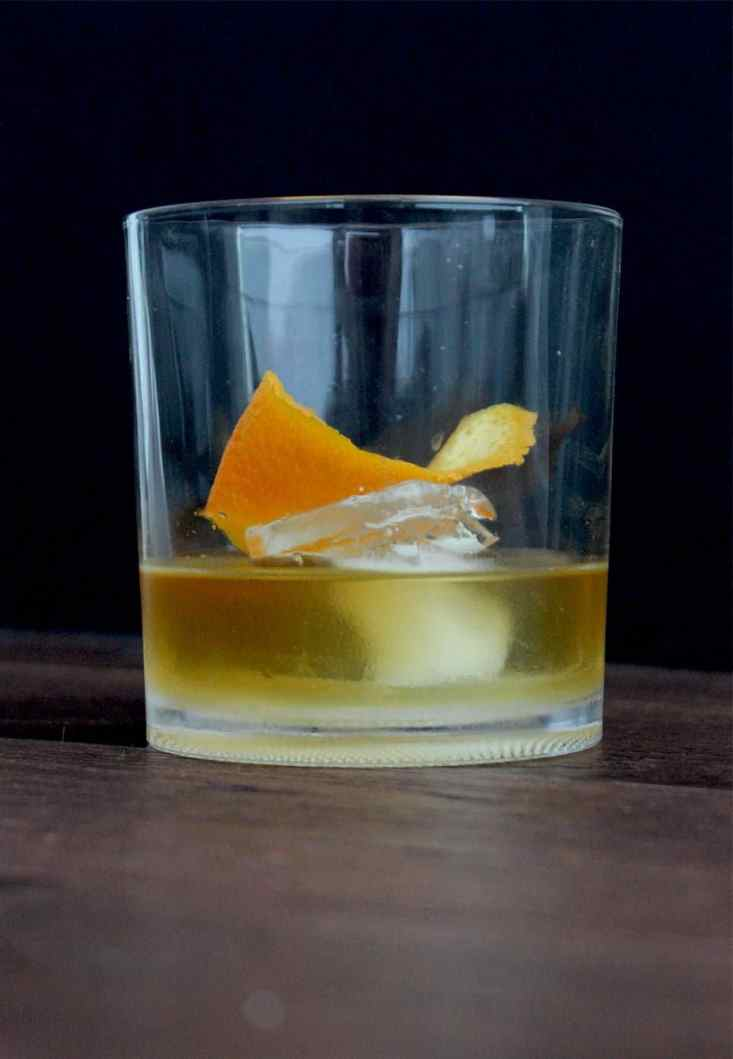 A smokey old fashioned with orange garnish