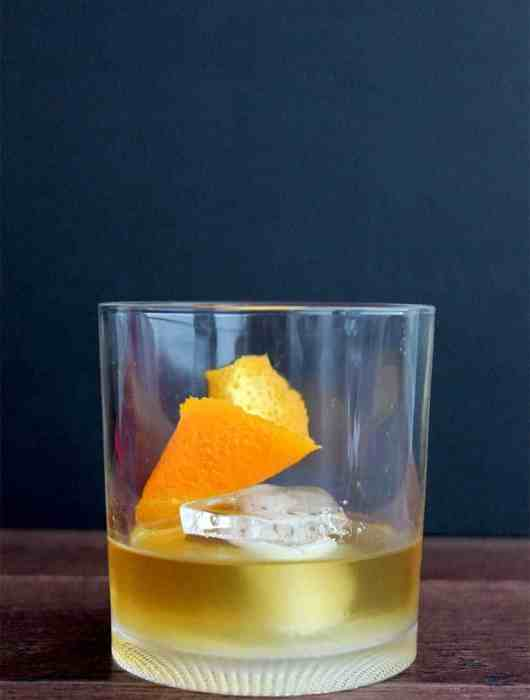 A smokey old fashioned on a dark background