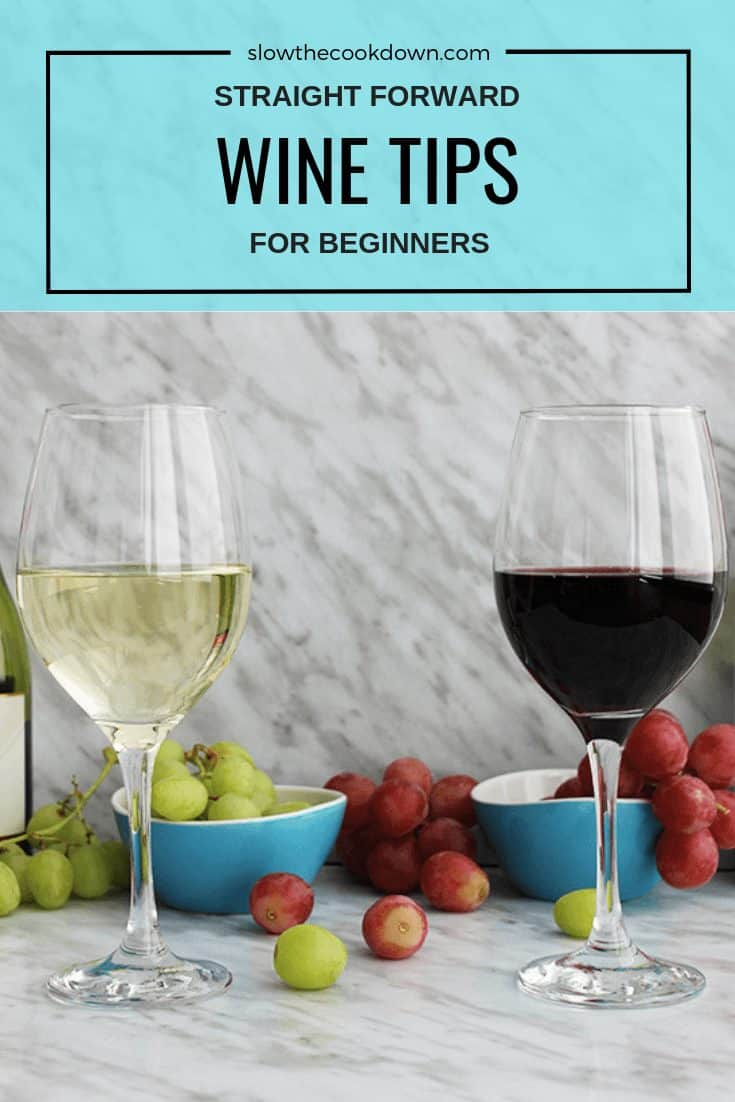 Two glasses of wine with grapes in the background. Pinterest image