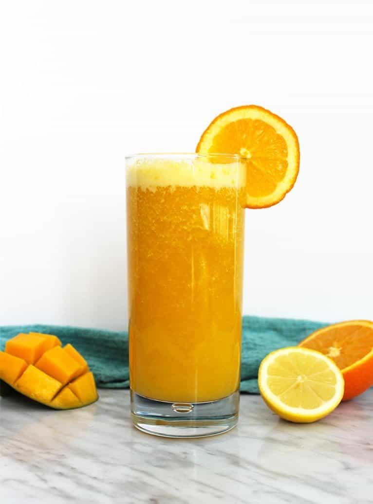 Anti inflammatory smoothie next to fresh fruit