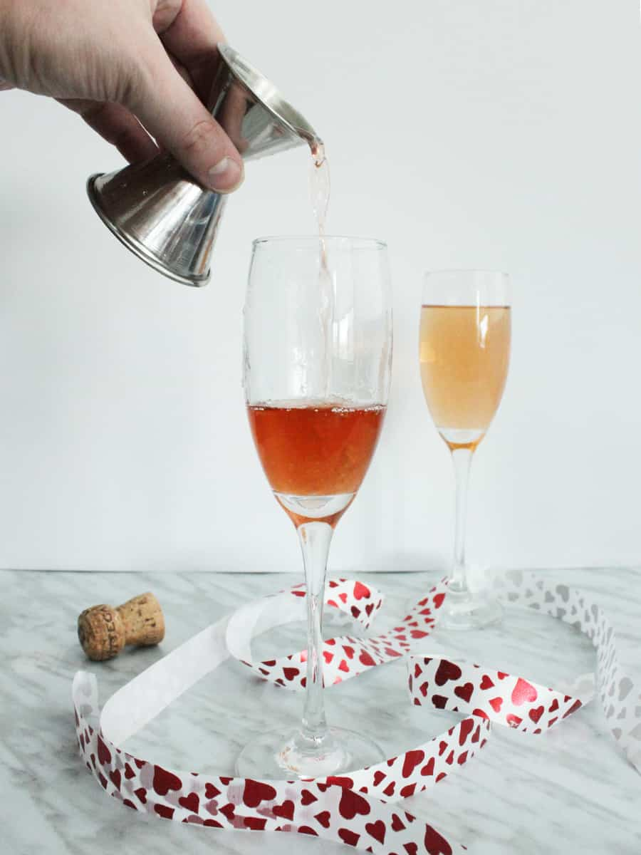 Grapefruit liquor being poured into a champagne glass