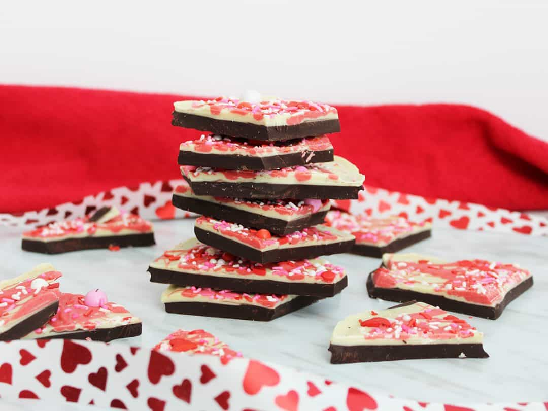 Chocolate bark stacked with red heart ribbon