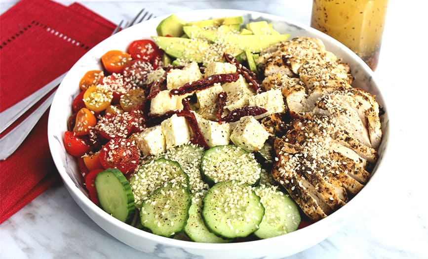 A large bowl of Grilled Lemon and Herb Chicken Salad