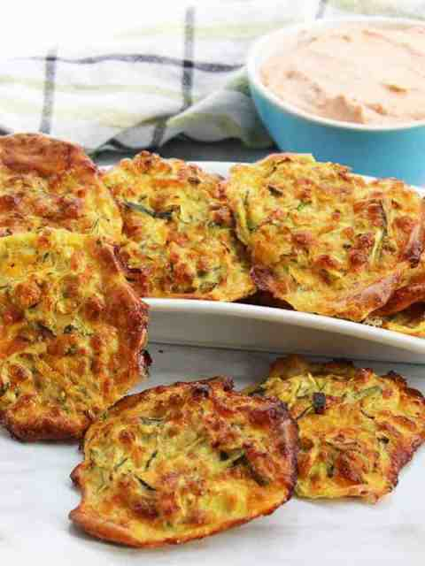 Baked zucchini fritters on a white serving dish