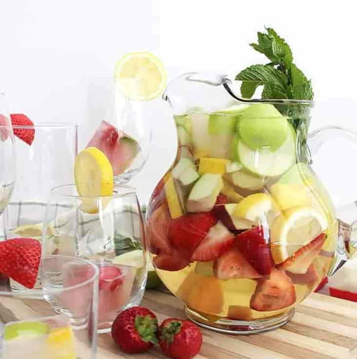 A jug of white wine sangria with fresh fruit
