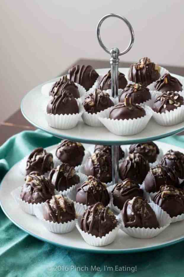 coconut milk truffles on a cake stand