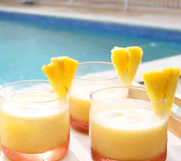 coconut pineapple cocktail in three glasses