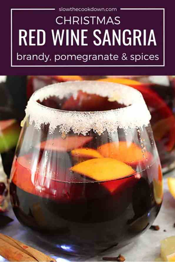 Pinterest image. A glass of Christmas red wine sangria with text overlay