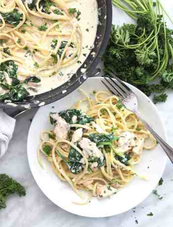 A plate of lemon salmon pasta served from a skillet