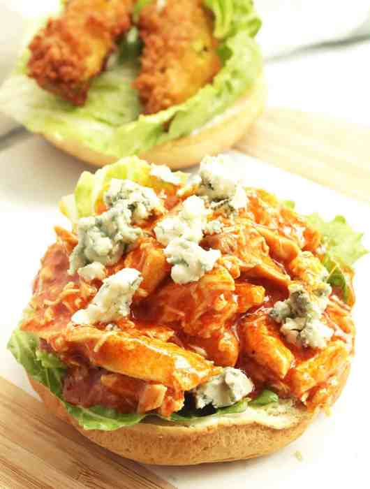The shredded bufflao chicken sandwich without the top bun on it