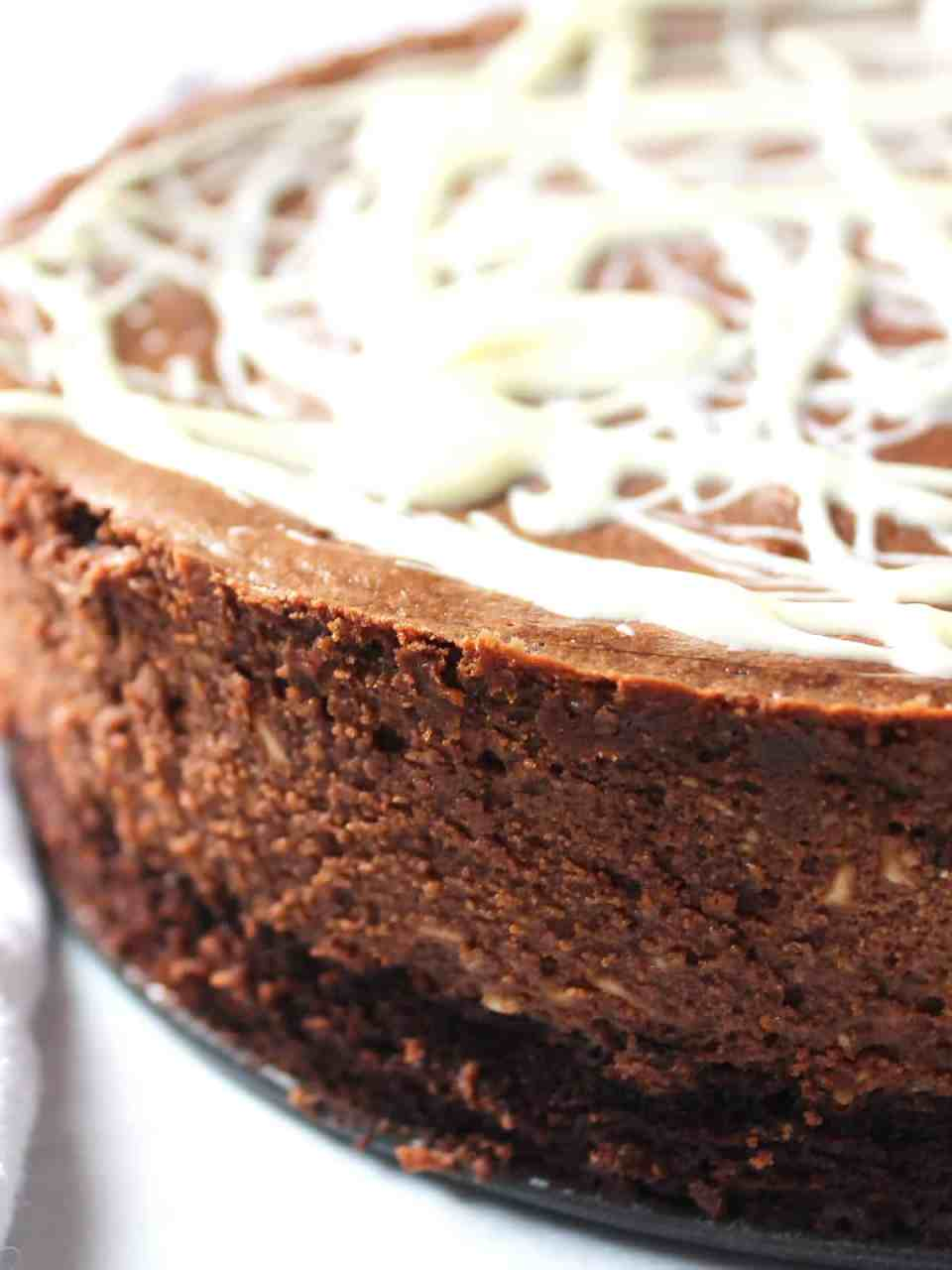 Close up of the side of the brownie bottomed cheesecake.
