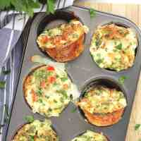 Four egg white bites baked in a muffin tin.