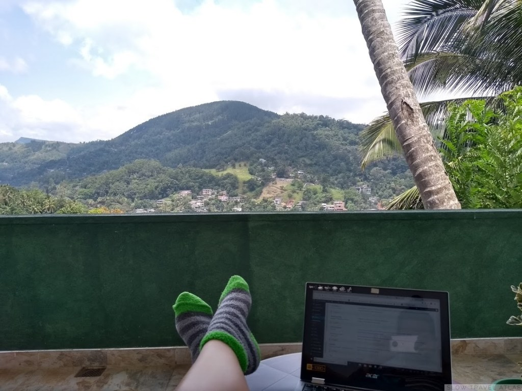 Laptop on a balcony with a view