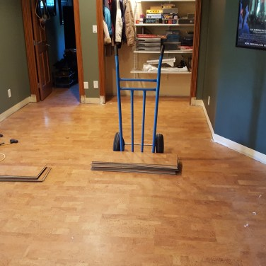 Before-The undamaged flooring was carefully removed and later resold by the customer, defraying the costs of the new flooring!