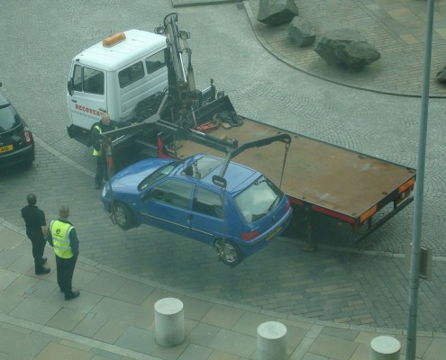 Car being lifted and towed away in front of Belfat Hilton Hotel in 2008