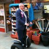 PUPs Brian Ervine on a Segway on an East Belfast pavement