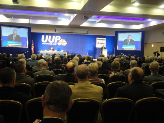 Looking over the heads of UUP conference delegates at Danny Kennedy