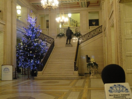 Parliament Buildings, Christmas tree with Paisley's portrait glaring down over the souls in the Great Hall
