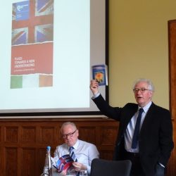 Paul Nolan holding 1995 flags book