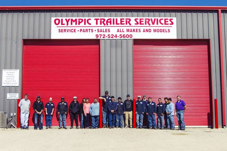 Olympic Trailer Services - sign and staff group picture
