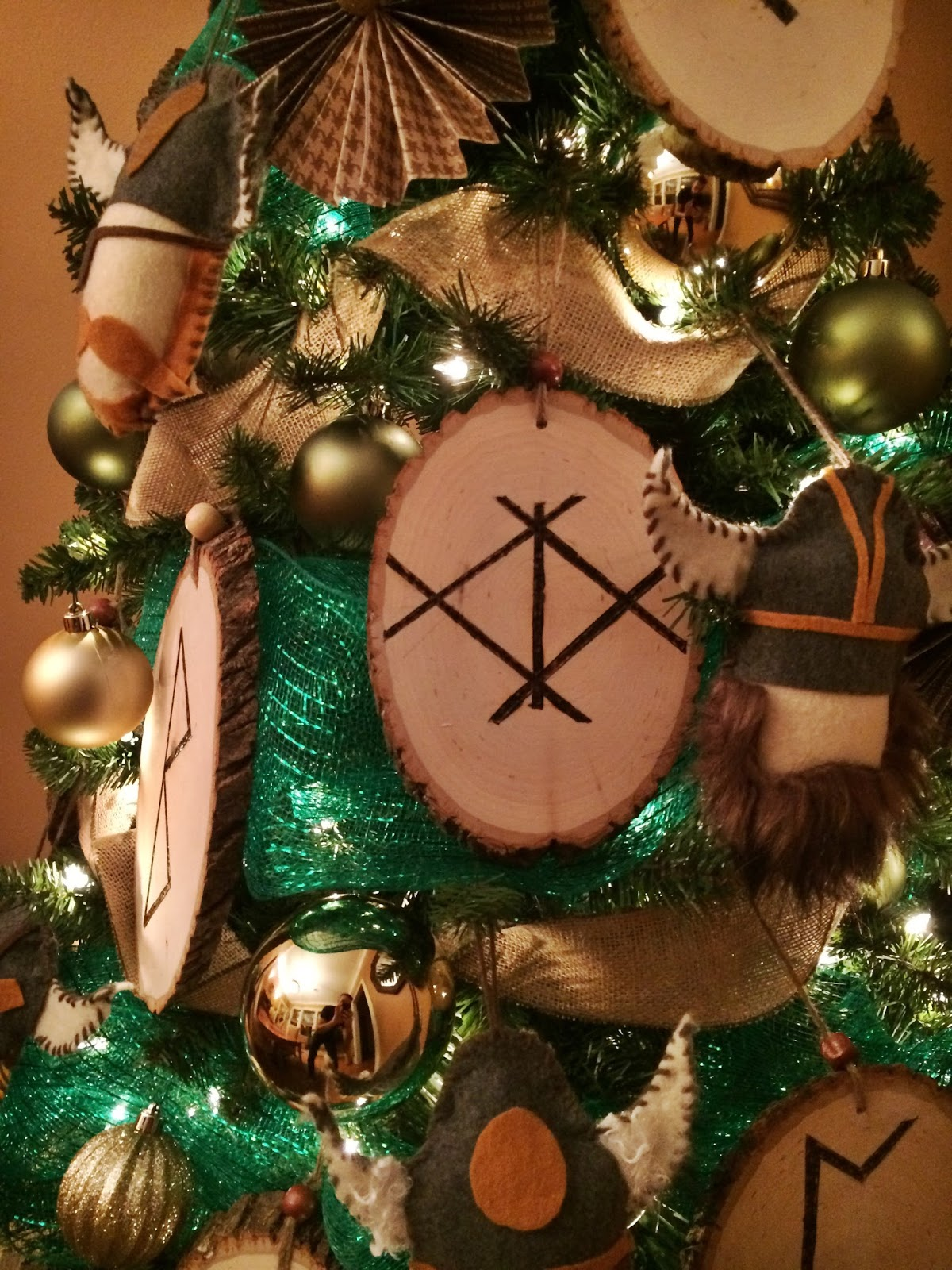 hand sewn felt viking ornaments and wooden country rounds with wood burned runic symbols are the main focal points on this tree - Viking Christmas