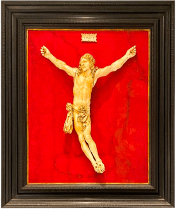 The Crucified Christ figure encased in a wooden frame