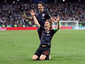 Croatia's Luka Modric celebrates with Sime Vrsaljko after scoring their second goal against Argentina on June 21, 2018